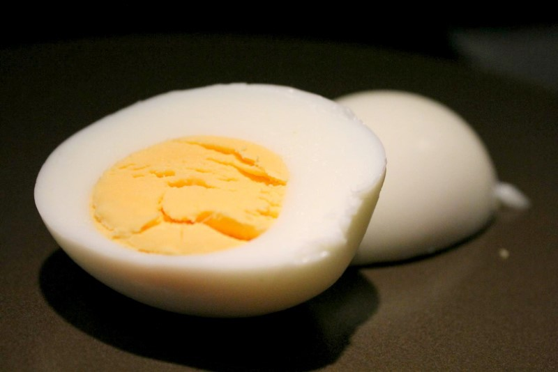 Hard boiled egg on brown plate