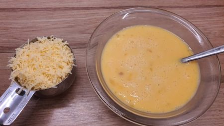 Grated cheddar and eggs