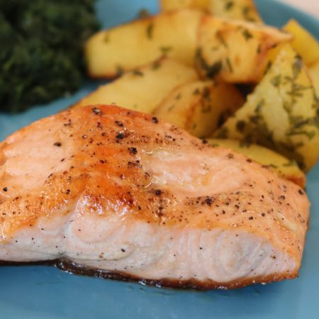 Baked salmon fillet with potatoes and garlic spinach square