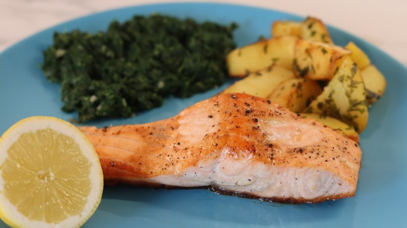 Baked salmon fillet with potatoes and spinach